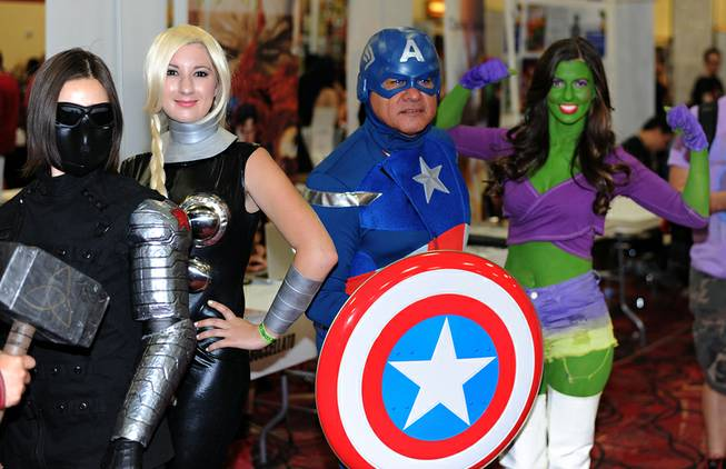 Fans of comic book heroes and villains pose in costume for photographs during the first day of the Las Vegas Comic Con at the South Point Convention Center on Saturday, June 21, 2014.