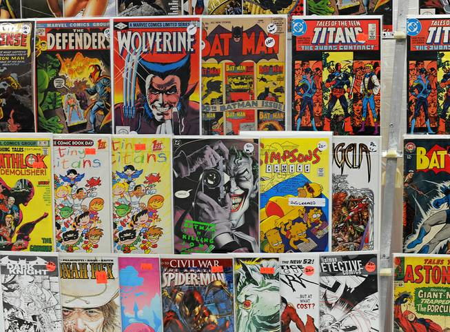 Comic books old and new are displayed for sale in a booth during the first day of the Las Vegas Comic Con at the South Point Convention Center on Saturday, June 21, 2014.