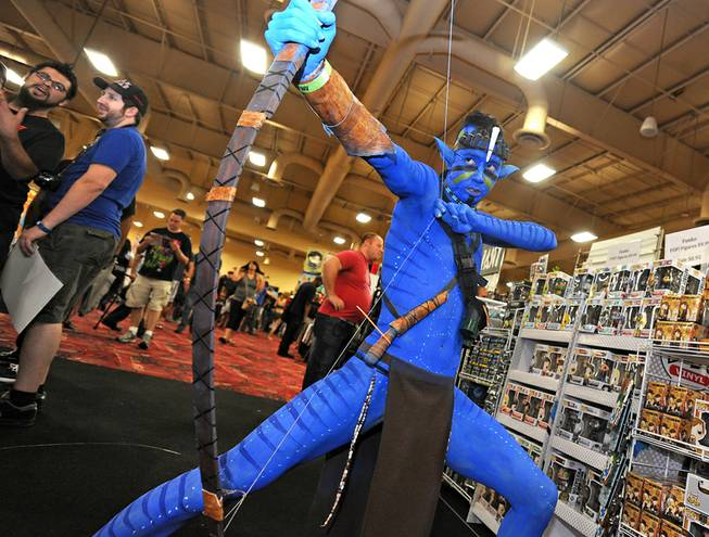 "Yasu Tano of Las Vegas poses in costume as a Na'vi from the movie ""Avatar"" during the first day of the Las Vegas Comic Con at the South Point Convention Center on Saturday, June 21, 2014."