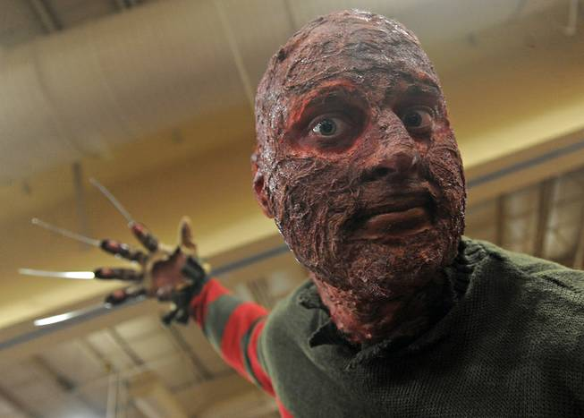 Andrew Meyers poses as movie dream killer Freddy Krueger during the first day of the Las Vegas Comic Con at the South Point Convention Center on Saturday, June 21, 2014.