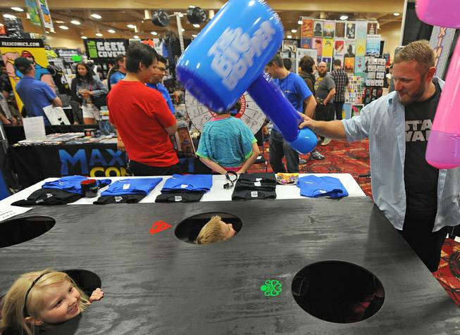 "The Davidson family plays ""Whack-a-nerd"" during the first day of the Las Vegas Comic Con at the South Point Convention Center on Saturday, June 21, 2014."