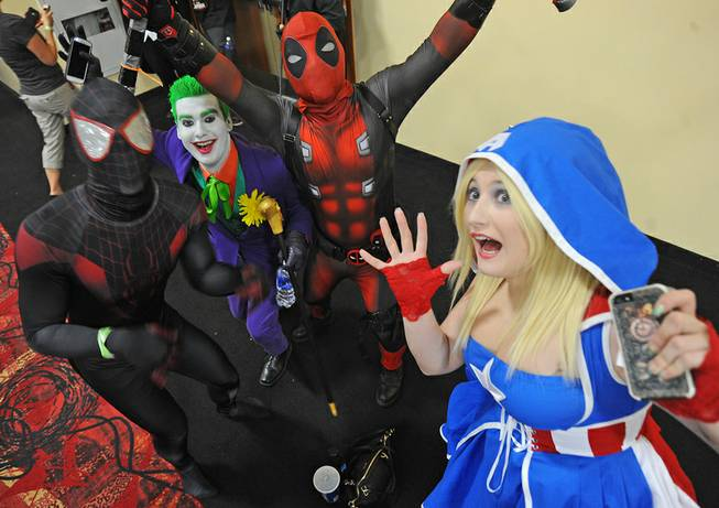 Costumed comic book fans pose for a photograph while attending the first day of the Las Vegas Comic Con at the South Point Convention Center on Saturday, June 21, 2014.