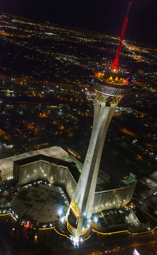The Stratosphere and the Strip are seen from a Maverick helicopter on the way to opening night of Electric Daisy Carnival at the Las Vegas Motor Speedway on Friday, June 20, 2014.