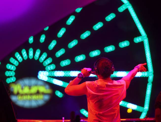 A DJ pumps up the crowd during opening night of EDC at the Las Vegas Motor Speedway on Friday, June 20, 2014.