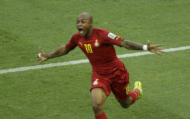 Ghana's Andre Ayew celebrates scoring his side's first goal during the World Cup soccer match between Germany and Ghana at the Arena Castelao in Fortaleza, Brazil, on Saturday, June 21, 2014.