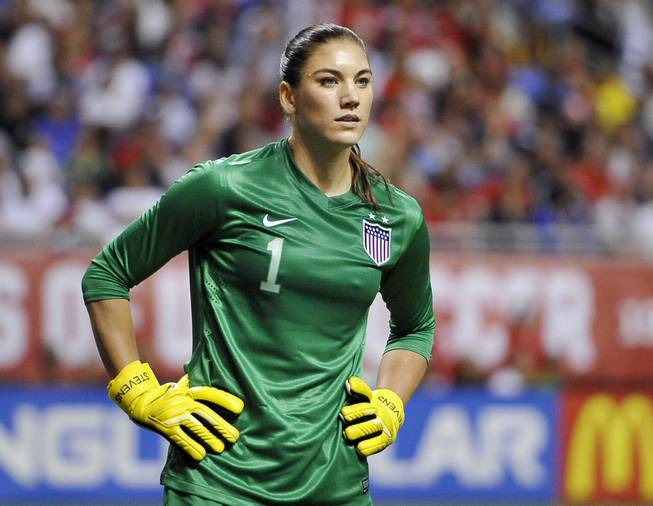 In this Oct. 20, 2013, file photo, U.S. goalkeeper Hope Solo pauses on the field during the second half of an international friendly women's soccer match against Australia in San Antonio.