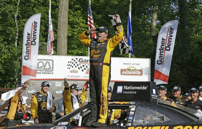 Brendan Gaughan celebrates after winning the NASCAR Nationwide series auto race at Road America in Elkhart Lake, Wis., on Saturday, June, 21, 2014.