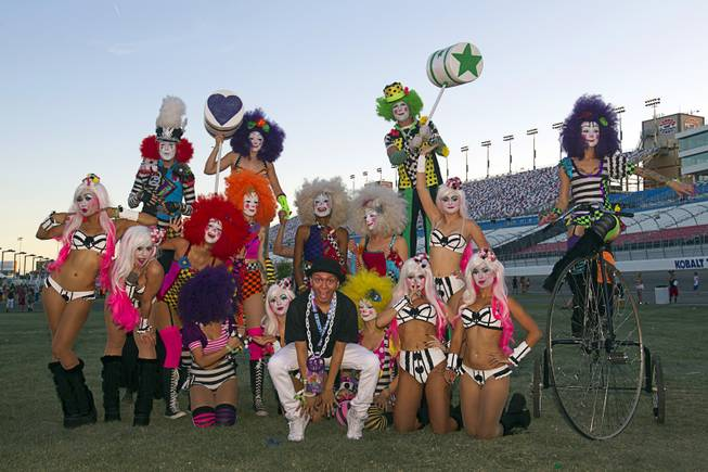 "Steven Corona, center, of Hollywood, Calif. poses with performers ""Team EZ"" during the final day of the 2014 Electric Daisy Carnival (EDC) at the Las Vegas Motor Speedway Sunday, June 22, 2014."