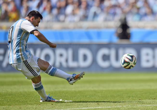 Argentina's Lionel Messi takes a free kick during the group F World Cup soccer match between Argentina and Iran at the Mineirao Stadium in Belo Horizonte, Brazil, Saturday, June 21, 2014.