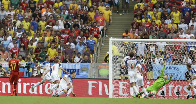 Belgium's Divock Origi (17) watches as his shot goes past Russia's goalkeeper Igor Akinfeev to score his side's first goal during the group H World Cup soccer match between Belgium and Russia at the Maracana Stadium in Rio de Janeiro, Brazil, Sunday, June 22, 2014.