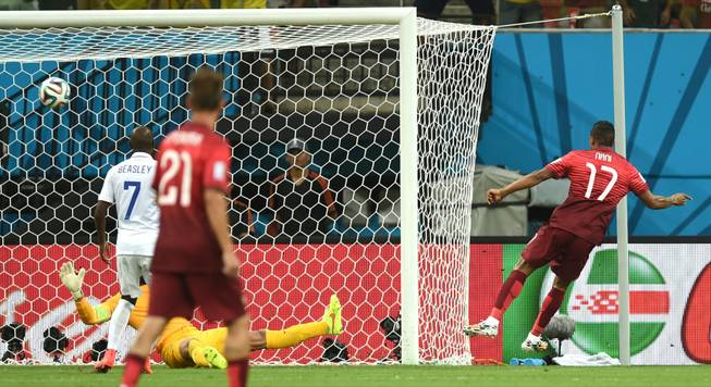 Portugal's Nani, right, scores the opening goal during the group G World Cup soccer match between the USA and Portugal at the Arena da Amazonia in Manaus, Brazil, Sunday, June 22, 2014.
