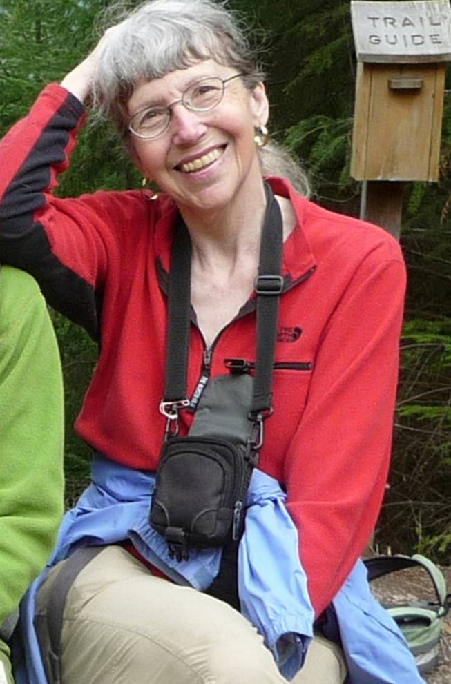 This undated photo provided by Lola Kemp shows Karen Sykes. Crews have been searching Mount Rainier National Park for Sykes, an outdoors writer, who was reported missing late Wednesday, June 18, 2014, while she researched a story. The search was suspended Saturday when a female's body was recovered, though the remains weren't immediately identified.
