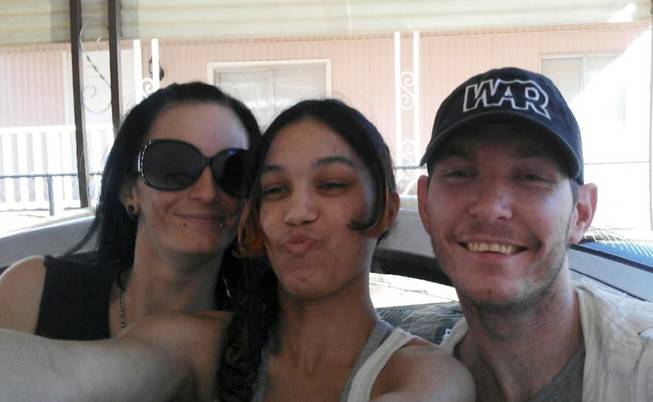 This undated image provided courtesy of Jeremy Tanner shows Las Vegas shooting victim Joseph Wilcox, right, along with his sisters Angel Wilcox, left, and C.J. Foster. Wilcox died June 8, 2014, after trying to confront an armed gunman inside a Las Vegas Wal-Mart.