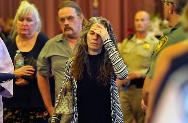 Debra Wilcox, mother of of Joseph Wilcox, exits the chapel after a memorial service at Palm Downtown Mortuary and Cemetery on Sunday, June 22, 2014. Wilcox, 31, was killed trying to stop Jerad and Amanda Miller in the midst of their shooting spree at an east valley Walmart store on June 8.