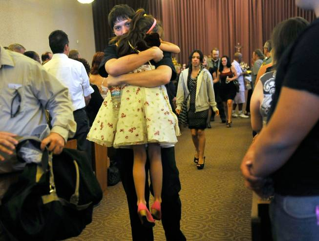 Family members of Joseph Wilcox exit the chapel after a memorial service at Palm Downtown Mortuary and Cemetery on Sunday, June 22, 2014. Wilcox, 31, was killed trying to stop Jerad and Amanda Miller in the midst of their shooting spree at an east valley Walmart store on June 8.