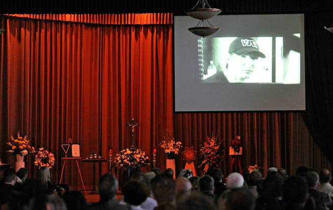 A video monitor displays an image of Joseph Wilcox during a memorial service for him at Palm Downtown Mortuary and Cemetery on Sunday, June 22, 2014. Wilcox, 31, was killed trying to stop Jerad and Amanda Miller in the midst of their shooting spree at an east valley Walmart store on June 8.