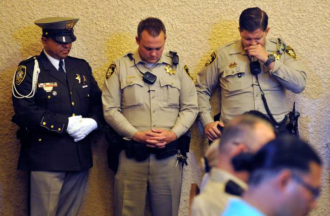 Las Vegas police bow their heads during a memorial service for Joseph Wilcox at Palm Downtown Mortuary and Cemetery on Sunday, June 22, 2014. Wilcox, 31, was killed trying to stop Jerad and Amanda Miller in the midst of their shooting spree at an east valley Walmart store on June 8.