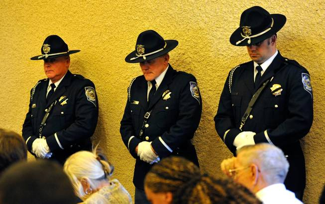 Members of the Nevada Highway Patrol Honor Guard bow their heads during a memorial service for Joseph Wilcox at Palm Downtown Mortuary and Cemetery on Sunday, June 22, 2014. Wilcox, 31, was killed trying to stop Jerad and Amanda Miller in the midst of their shooting spree at an east valley Walmart store on June 8.