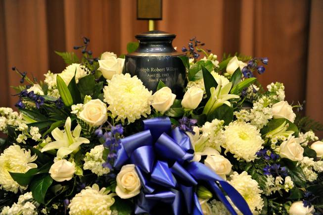 An urn containing the remains of Joseph Wilcox is displayed during a memorial service for him at Palm Downtown Mortuary and Cemetery on Sunday, June 22, 2014. Wilcox, 31, was killed trying to stop Jerad and Amanda Miller in the midst of their shooting spree at an east valley Walmart store on June 8.