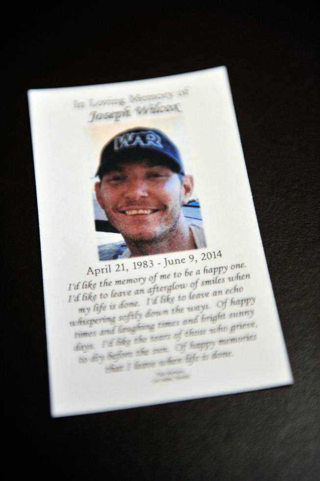 A mass card is displayed during a memorial service for Joseph Wilcox at Palm Downtown Mortuary and Cemetery on Sunday, June 22, 2014. Wilcox, 31, was killed trying to stop Jerad and Amanda Miller in the midst of their shooting spree at an east valley Walmart store on June 8.