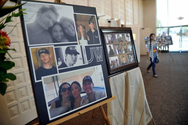 A poster of photographs of Joseph Wilcox is displayed before a memorial service at Palm Downtown Mortuary and Cemetery on Sunday, June 22, 2014. Wilcox, 31, was killed trying to stop Jerad and Amanda Miller in the midst of their shooting spree at an east valley Walmart store on June 8.