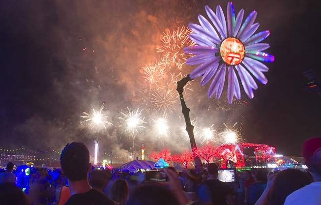 Attendees watch fireworks during the final night of the 2014 Electric Daisy Carnival on Sunday, June 22, 2014, at Las Vegas Motor Speedway.