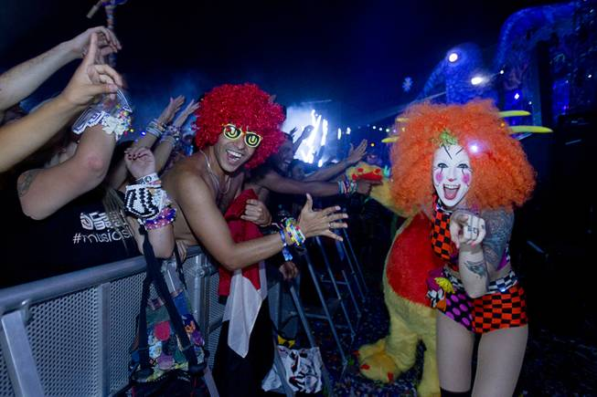 "A ""Team EZ"" performer is shown with a fan during the final night of the 2014 Electric Daisy Carnival (EDC) at the Las Vegas Motor Speedway Sunday, June 22, 2014."