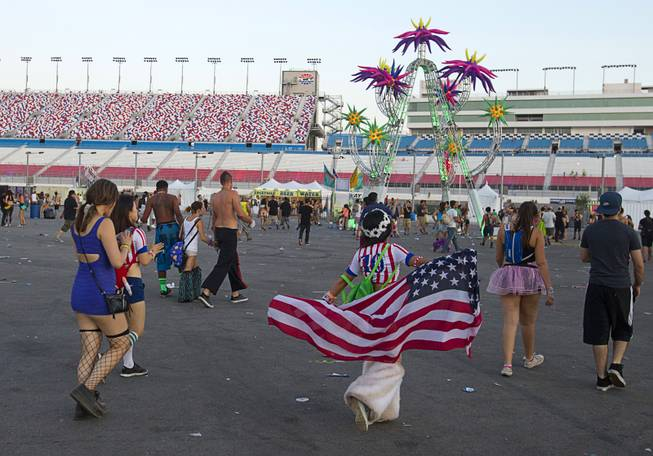 As the sun rises, fans head for the exits after the final night of the 2014 Electric Daisy Carnival (EDC) at the Las Vegas Motor Speedway Sunday, June 22, 2014.