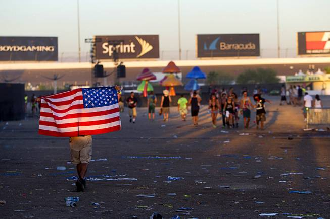 A fan heads to an exit after the final night of the 2014 Electric Daisy Carnival (EDC) at the Las Vegas Motor Speedway Sunday, June 22, 2014.