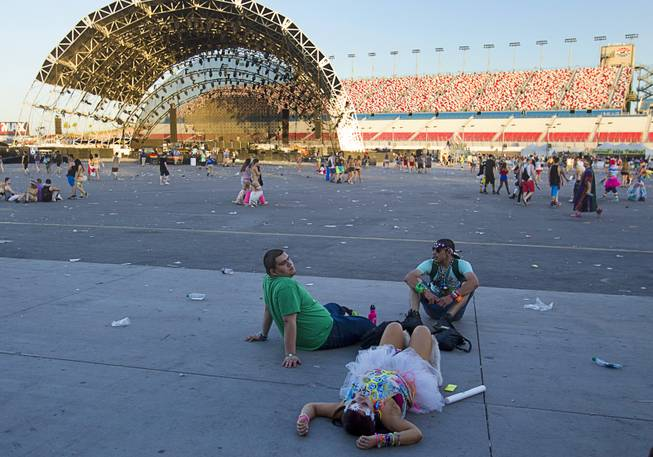 Fans relax on the pavement after the final night of the 2014 Electric Daisy Carnival (EDC) at the Las Vegas Motor Speedway Sunday, June 22, 2014.