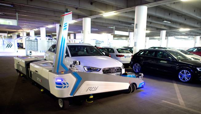 "Parking robot ""Ray"" transports a car in Duesseldorf, Germany, Monday, 23 June 2014. The parking robot will see service for the first time at Duesseldorf Airport."