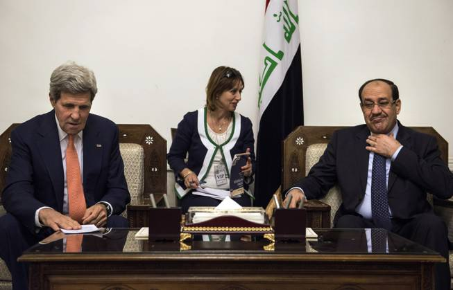 Iraqi Prime Minister Nouri al-Maliki, right, meets with U.S. Secretary of State John Kerry, left, at the Prime Minister's office in Baghdad, Iraq, Monday, June 23, 2014.