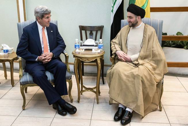 Ammar al-Hakim, right, head of the Shiite Supreme Islamic Iraqi Council, meets with U.S. Secretary of State John Kerry, left, in Baghdad on Monday, June 23, 2014.