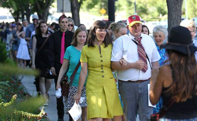 Kate Kelly, center, walks with supporters to the Church Office Building of the Church of Jesus Christ of Latter-day Saints during a vigil Sunday, June 22, 2014, in Salt Lake City.