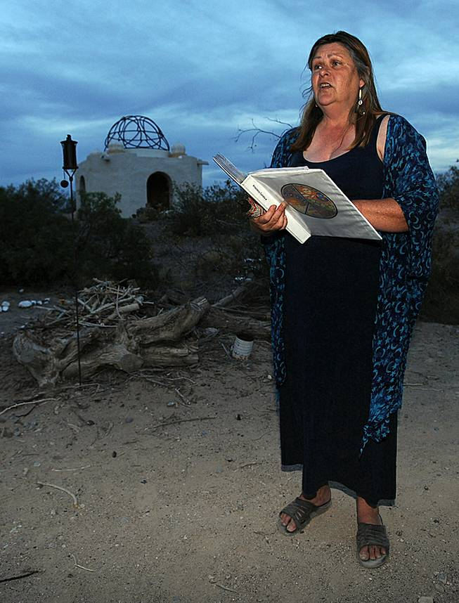 Priestess Canace Ross addresses a small gathering of people outside a temple in the desert near Indian Springs before hosting a Litha ceremony, a Wiccan tradition honoring the summer solstice on Saturday evening.