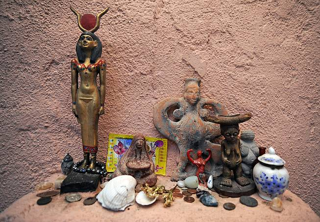 Figurines representing female deities of various cultures and religions adorn a small shelf inside the Temple of Goddess Spirituality dedicated to Sekhmet, a small temple located in the desert outskirts of Indian Springs.