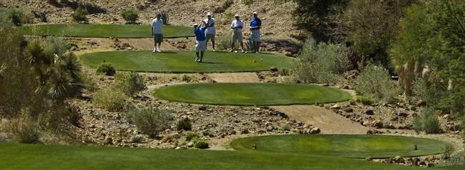 Golfers tee off as HELP of Southern Nevada hosts its 20th Annual Golfers Roundup at Cascata Golf Course in Boulder City on Tuesday, June 24, 2014.