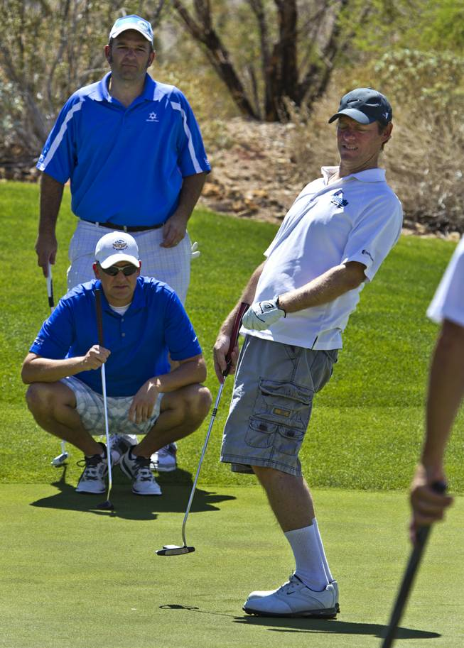 Kyle Clingo reacts to a barely missed putt as HELP of Southern Nevada hosts its 20th Annual Golfers Roundup at Cascata Golf Course in Boulder City on Tuesday, June 24, 2014.