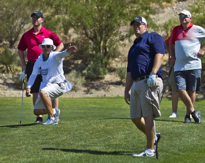 Golfers enjoy a round as HELP of Southern Nevada hosts its 20th Annual Golfers Roundup at Cascata Golf Course in Boulder City on Tuesday, June 24, 2014.
