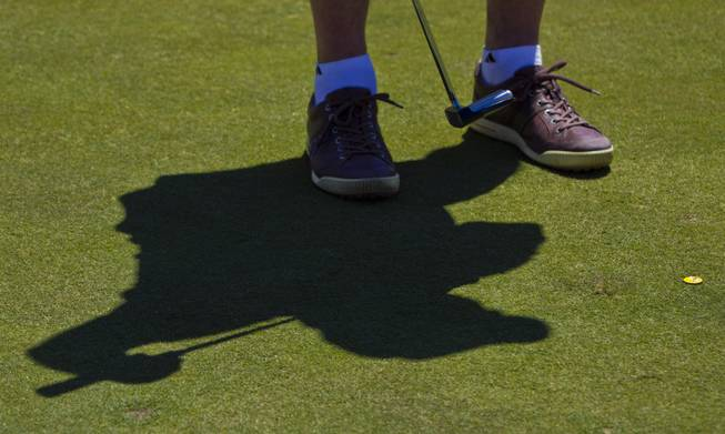 Michael Rubino putts as HELP of Southern Nevada hosts its 20th Annual Golfers Roundup at Cascata Golf Course in Boulder City on Tuesday, June 24, 2014.