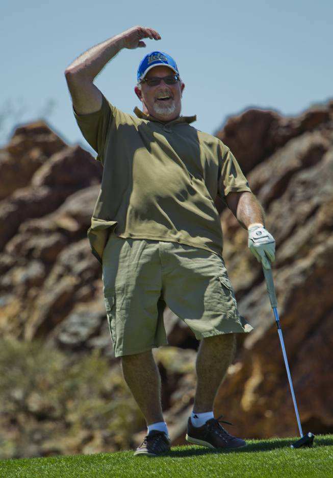 Michael Rubino celebrates after sinking a great putt as HELP of Southern Nevada hosts its 20th Annual Golfers Roundup at Cascata Golf Course in Boulder City on Tuesday, June 24, 2014.