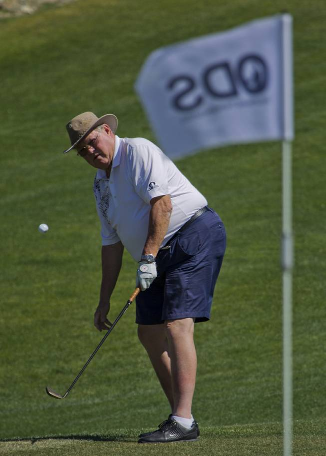 Cary Fisher chips the ball to the green as HELP of Southern Nevada hosts its 20th Annual Golfers Roundup at Cascata Golf Course in Boulder City on Tuesday, June 24, 2014.
