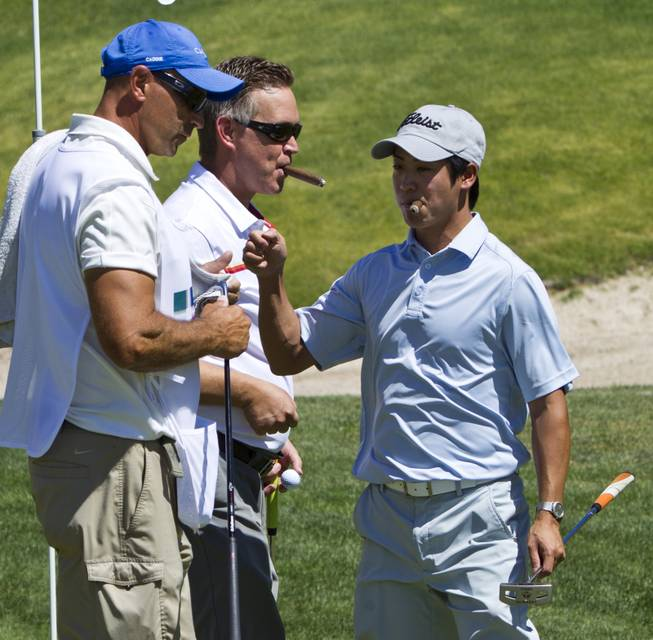 Dan Lai (right) celebrates a great putt with teammates as HELP of Southern Nevada hosts its 20th Annual Golfers Roundup at Cascata Golf Course in Boulder City on Tuesday, June 24, 2014.