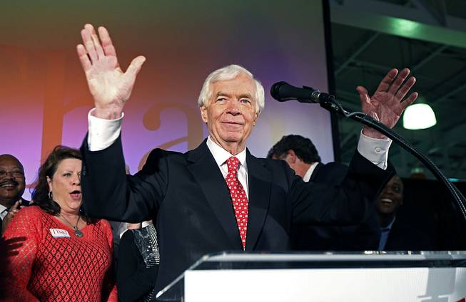U.S. Sen. Thad Cochran, R-Miss., waves to supporters and volunteers at his runoff election victory party Tuesday, June 24, 2014, at the Mississippi Children's Museum in Jackson, Miss.