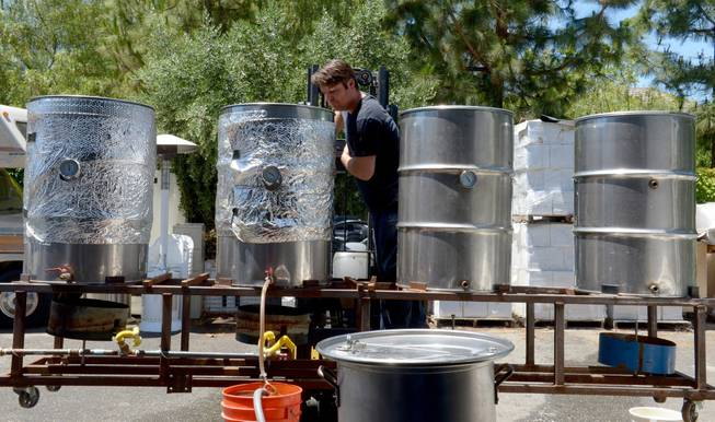 Army veteran Eric Johnson, of Fremont, checks on a cooling brew at Uncle Sam's Misguided Brewery in Livermore, Calif., on Monday, May 26, 2014. The brewery is run by fellow veterans and co-owners Josh Laine and Fara Eve Barnes.