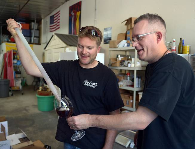 Veteran Josh Laine, co-owner of Uncle Sam's Misguided Brewery, pours a sampling of Miracle Black Ale for fellow Marine Corps veteran Andy Kulakowski on Memorial Day in Livermore, Calif., on Monday, May 26, 2014. Free tastings were part of the day's event for all veterans.