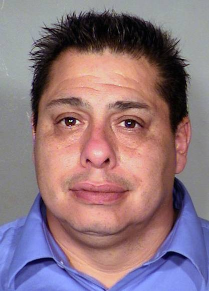"This Thursday, Jan. 16, 2014, booking photo provided by Las Vegas Metropolitan Police Department of Carlos Enrique Barron of North Las Vegas, Nev. Barron, 43, was sentenced Tuesday, June 24, 2014, to 90 days in jail and five years' probation for an April 2011 shooting involving a crew of the reality TV show ""Repo Games"" in his North Las Vegas neighborhood."