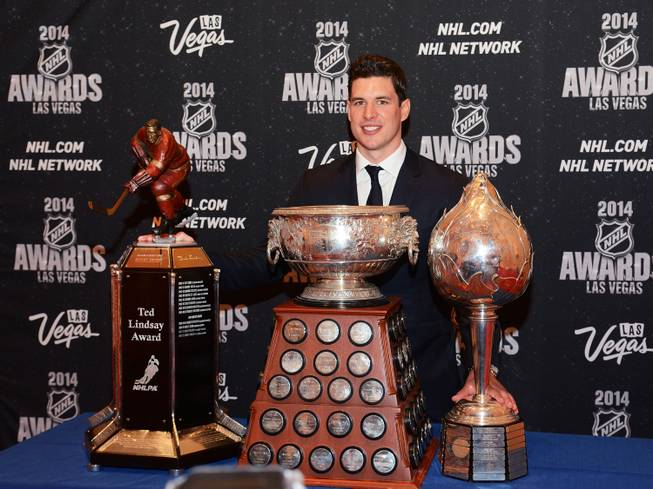 Sidney Crosby of the Pittsburgh Penguins with his Ted Lindsay, Art Ross and Hart Memorial trophies at the 2014 NHL Awards in Encore Theater on Tuesday, June 24, 2014, at Wynn Las Vegas.