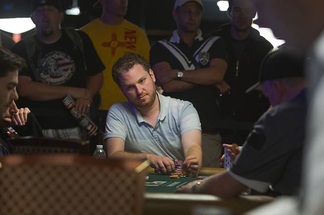 Poker player Scott Seiver, center, competes in the $50,000 World Series of Poker's Players' Championship at the Rio Wednesday, June 25, 2014.
