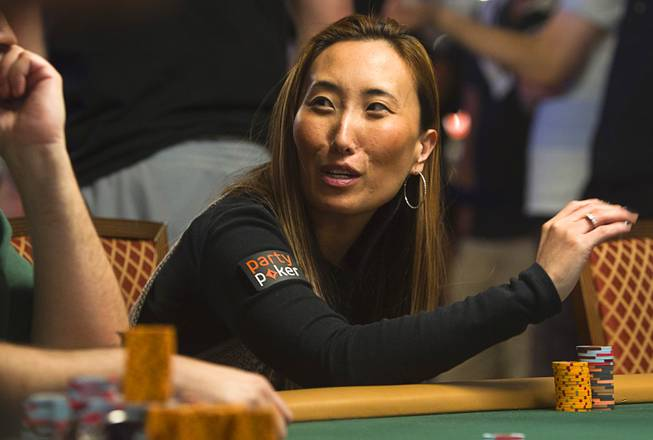 Poker player Melissa Burr competes in the $50,000 World Series of Poker's Players' Championship at the Rio Wednesday, June 25, 2014.